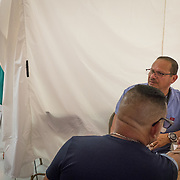 OCTOBER 24 - PONCE, PUERTO RICO - <br /> A patient has his vitals checked inside temporary hospital tents set up outside the Ponce VA hospital which suffered damage due to the passing of Hurricane Maria.<br /> (Photo by Angel Valentin/Freelance)