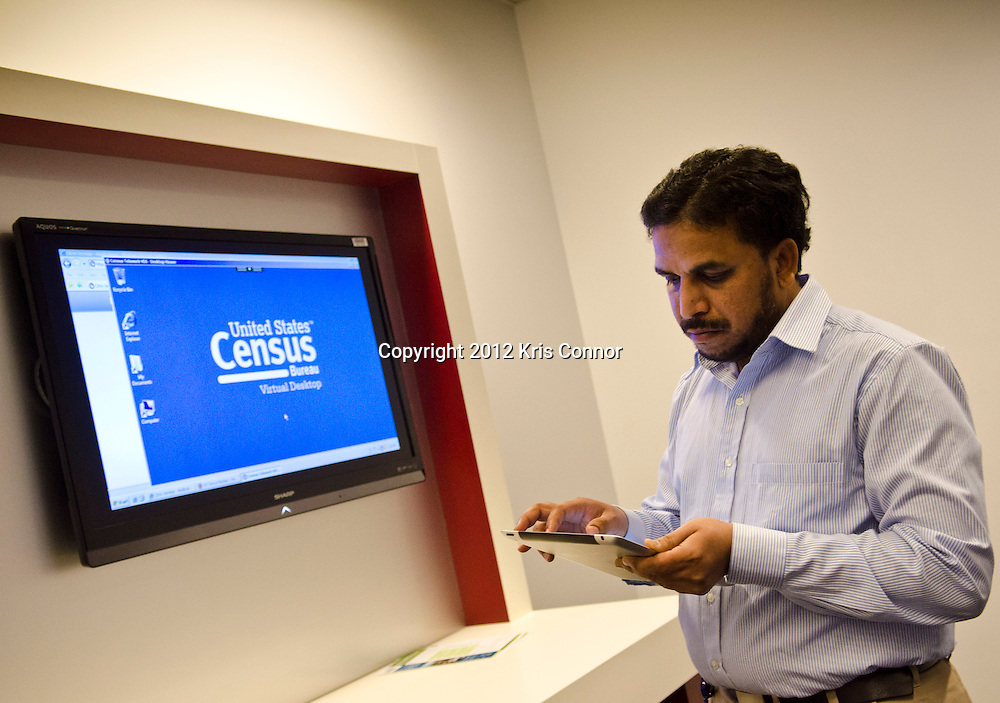 Saleem A Shaik, a consultant, test out the ipad during a tour at the Center for Applied Technology lab at the Census Bureau headquarters in Suitland, Maryland on April 4, 2012. The bureau is looking at the Apple Ipad and other handheld devices to help get information during the 2020 census. Photo by Kris Connor