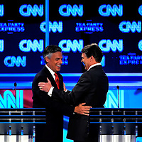 TAMPA, FL -- September 12, 2011 -- Republican Presidential candidates Jon Huntsman and Gov. Rick Perry hug during a break at the CNN/Tea Party Republican Debate at the Florida State Fairgrounds on Monday, September 12, 2011.  Eight Republican Presidential candidates squared off with host Wolf Blitzer in the battleground state of Florida for the 2012 Election.    (Chip Litherland for The New York Times)