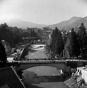 06/03/1957<br /> 03/06/1957<br /> 06 March 1957<br /> View of river and bridge at Lourdes, France.