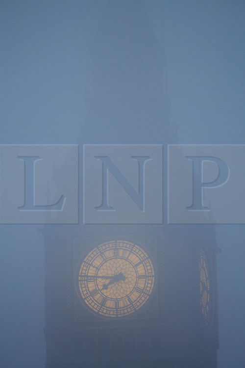 © licensed to London News Pictures. London, UK 21/01/2014. Big Ben disappears into fog, early morning in central London on January 21, 2014. Photo credit: Tolga Akmen/LNP