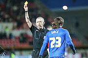Gillingham's Bradley Dack receives a yellow card from referee Fred Graham during the Sky Bet League 1 match between Swindon Town and Gillingham at the County Ground, Swindon, England on 26 December 2015. Photo by Shane Healey.