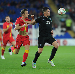 James McClean of Republic of Ireland  shields the ball from  Andy King of Wales  - Photo mandatory by-line: Alex James/JMP - Tel: Mobile: 07966 386802 14/08/2013 - SPORT - FOOTBALL - Cardiff City Stadium - Cardiff -  Wales V Republic of Ireland - International Friendly