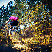 Alex Bardsley gets air off a jump in the woods of Missoula, Montana.