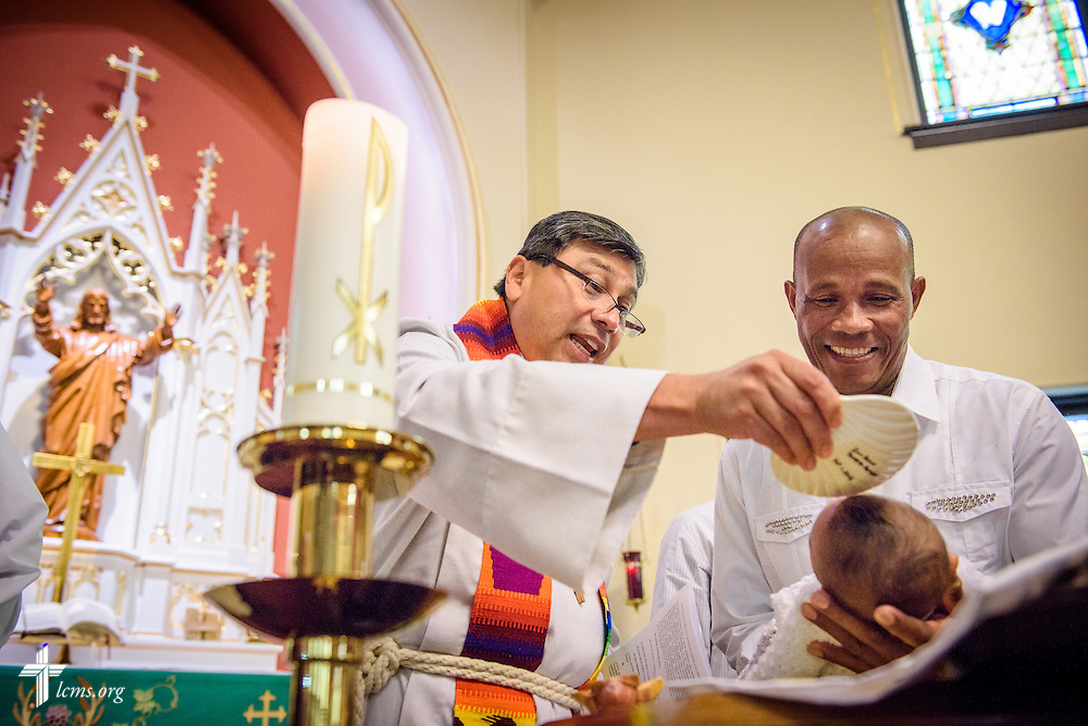 The Rev. Pablo Dominguez, pastor of a Hispanic mission in the LCMS Central Illinois District, baptizes Ian Terrero-Toribio, held by Pedro Perez, on Saturday, Oct. 1, 2016, at St. John's Lutheran Church in Beardstown, Ill. LCMS Communications/Erik M. Lunsford