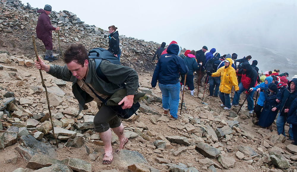 Barefooted pilgrim Don O'Meara from Ballinhassig, Co. Cork makes his way up the mountain for the first time on pilgrimage to  Croagh Patrick, Co. Mayo. Pic: Michael Mc Laughlin