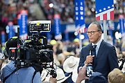 NBC Nightly news anchor Lester Holt reports from the floor of the Republican National Convention at the Quicken Loans Center July 18, 2016 in Cleveland, Ohio.