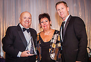 From left, Honorable Patrick Huels, Carol Schneider, President of Mercy Hospital & Medical Center, and Thomas Caplis, Chair, Mercy Foundation, Inc. Board of Directors presents an award to Honorable Patrick Huels at the Mercy Hospital & Medical Center's 51st Dinner Dance Gala at the Hilton Chicago on September 28, 2018. (Photo:Natalie Battaglia)