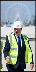 Celebration of the 2012 Olympic Games volunteering one year on. <br />  The Prime Minister of the United Kingdom David Cameron and Mayor of London Boris Johnson meet construction workers at the  Queen Elizabeth Olympic Park.<br /> Mayor of London Boris Johnson and Lord Coe will be taking to the stage at Go Local to encourage a new drive in volunteering one year on from the Games. Also present are multi-platinum selling pop rock band McFly; world famous comedian Eddie Izzard, Brit Award nominated The Feeling, and Britain'Got Talent winners Attraction, in addition to stars Jack Carroll and Gabz. The event will be the UKs biggest ever celebration of volunteering and first Olympic and Paralympic legacy event at Queen Elizabeth Olympic Park.<br /> London, United Kingdom<br /> Friday, 19th July 2013<br /> Picture by Andrew Parsons / i-Images