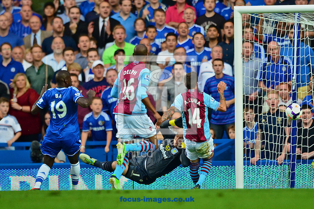 Picture by Ian Wadkins/Focus Images Ltd +44 7877 568959<br /> 21/08/2013<br /> Brad Guzan of Aston Villa can't prevent Eden Hazard of Chelsea scoring to make it 1-0 during the Barclays Premier League match at Stamford Bridge, London.