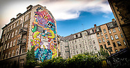 A view of some graffiti street art lining a building in Outer Frederiksberg in Copenhagen.