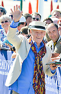 British actor Ian McKellen poses during the unveiling of his dedicated beach locker room on the Promenade des Planches during the 41st Deauville American Film Festival on September 10, 2015 in Deauville, France