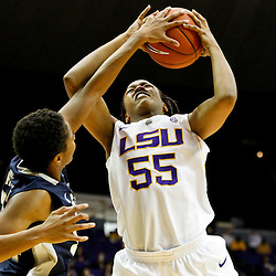 November 16, 2011; Baton Rouge, LA; Georgetown Hoyas guard Alexa Roche (34) blocks a shot of LSU Tigers forward LaSondra Barrett (55) during the first half of a game at the Pete Maravich Assembly Center.  Mandatory Credit: Derick E. Hingle-US PRESSWIRE