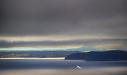 A Washington State Ferry makes its way into nearly fifty shades of grey towards Bainbridge Island and Kitsap County. (Mike Siegel / The Seattle Times)