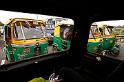 New Dehli, Dehli, IND, August 27th 2007:  Tuk tuk taxis in clogged up traffic on one of the highways in New Dehli.<br /> The Indian carmaker Tata have a cheap car in the pipeline. By 2008 the car that cost 100.000 rupees (appr. 1800 EURO) will hit the market, making automobiles affordable for millions of Indian people.