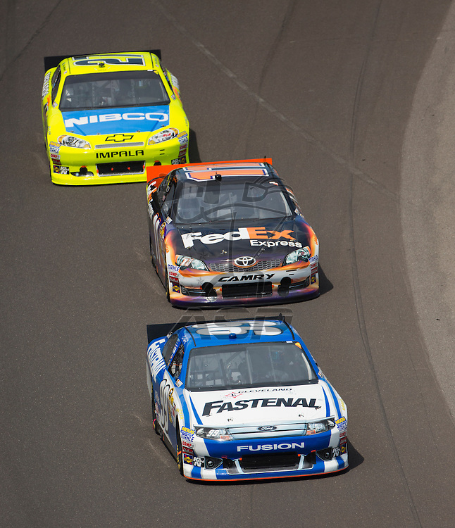 INDIANPOLIS, IN - JUL 29, 2012:  Carl Edwards (99) brings his car through the turns during the Curtiss Shaver 400 presented by Crown Royal Sprint Cup Series race at the Indianapolis Motor Speedway in Indianapolis, IN.