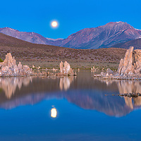 Setting of the Super Moon behind the Eastern Sierra mountains, and reflecting in Mono Lake. Lee Vining, California