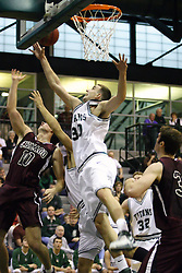 16 December 2006: Zach Freeman and Adam Machones reach for the same rebound. The University of Chicago Maroons upset  the Illinois Wesleyan Titans 64 - 60 at the Shirk Center in Bloomington Illinois.<br />
