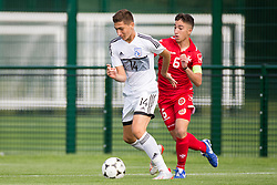 WREXHAM, WALES - Thursday, August 15, 2019: Cyprus' Constantinos Panteli and Malta's captain Kian Leonardi during the UEFA Under-15's Development Tournament match between Cyprus and Malta at Colliers Park. (Pic by Paul Greenwood/Propaganda)