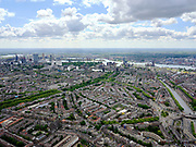Nederland, Zuid-Holland, Rotterdam; 14–05-2020; Rotterdam-West met overzicht van het Nieuwe Westen en Middelland. Links de Heemraadssingel (met bomen) en rechts water van de Delfshavense Schie. Skyline Rotterdam met Erasmus MC en de hoogbouw rond het station. Rivier de Nieuwe Maas.<br /> Rotterdam-West with an overview of the New West and Midland. On the left the Heemraadssingel (with trees) and on the right the water of the Delfshavense Schie. Skyline Rotterdam with Erasmus MC and the high-rise around the station. River Nieuwe Maas.<br /> <br /> luchtfoto (toeslag op standaard tarieven);<br /> aerial photo (additional fee required)<br /> copyright © 2020 foto/photo Siebe Swart
