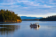 Fishermen on Lake James, in the foothills of the Blue Ridge Mountains, during a warm winter's day in Nebo, North Carolina<br />