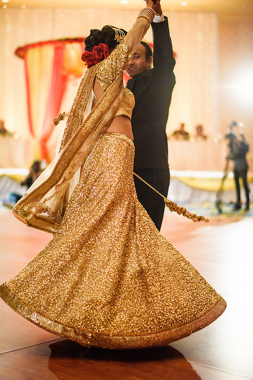 Baltimore, Maryland - December 20, 2014: Trisha Satya Pasricha and Eshwan Ramudu have their first dance.<br /> <br /> The couple, who met at Harvard, during a one of Trisha's student films, were married at the Baltimore Marriott Waterfront Hotel December 20, 2014. <br /> <br /> CREDIT: Matt Roth for The New York Times<br /> Assignment ID: 30168620A