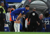 Football - 2017 / 2018 Premier League - Chelsea vs. Huddersfield Town<br /> <br /> Chelsea's Olivier Giroud shows his despair at the final whistle after only drawing the match, by biting his shirt at Stamford Bridge.<br /> <br /> COLORSPORT/ANDREW COWIE