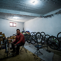 Isheten Gurung repairs a bike in his bike-rental shop, Muktinath, Nepal. Most of Isheten's customers are trekkers descending the Annapurna Circuit, who see the bikes as a knee-saving way to descend the 2000 vertical metre, 50 Kilometres of jeep road ahead.