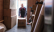 Financial Times commission for Business Life section, Working Lives.<br /> James Valentine, delivery driver for DPD pictured at their depot in Wimborne, Dorset.<br /> BL11.<br /> Picture date: Tuesday December 8, 2015.<br /> Photograph by Christopher Ison &copy;<br /> 07544044177<br /> chris@christopherison.com<br /> www.christopherison.com