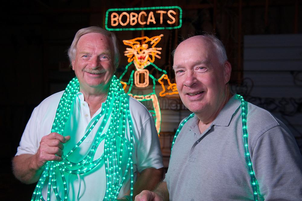 18996Belpre Holiday Lights: OU Alums Joseph Keesey(gray shirt) and James Rice(white shirt) working on OU Bobcat...http://belprelights.com/