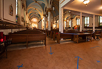 Directional arrows and taped off pews will assist parishioners with the social distancing guidelines inside Sacred Heart Church.  (Karen Bobotas/for the Laconia Daily Sun)