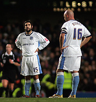 Photo: Paul Thomas.<br /> Chelsea v Wycombe Wanderers. Carling Cup, Semi Final 2nd Leg. 23/01/2007.<br /> <br /> Dejected Wycombe players (L-R) Jermaine Easter, Tommy Doherty and Tommy Mooney wait while Chelsea celebrate.
