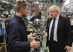 © licensed to London News Pictures. LONDON, UK.  02/06/11. Boris Johnson is shown the manufacturing process at Brompton Bicycles in West London. The Mayor of London Boris Johnson visits two major manufacturing firms today, 02 June 2011, to see the role they play in supporting London's economy and why the UK's capital city  is so critical to their continued success. He called in to Fuller's in Chiswick, London's only traditional family brewery, to see their new multi-million pound brewing facility. He went on to visit Brompton bike factory. Where he met Brompton inventor Andrew Ritchie, who still owns the famous company and remains its Technical Director.  Photo credit should read Stephen Simpson/LNP