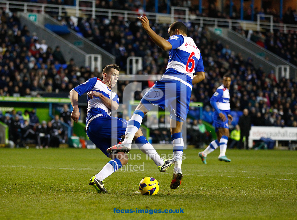 Picture by Andrew Tobin/Focus Images Ltd +44 7710 761829.12/01/2013.Ian Harte of Reading and Adrian Mariappa of Reading get in a mix up in defence during the Barclays Premier League match at the Madejski Stadium, Reading.