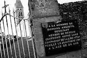 "Colleville sur Mer | Oct 15 2009..The curch ""Notre Dame de l´Assomption"" is seen through an iron gate in the french village of Colleville sur Mer. Colleville sur Mer was one of the first villages to be freed by Allied Forces entering Europe on June 6, 1944 (D-Day).  ..Photo: juelich/ip-photo.com"