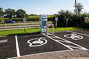 An electric car charging point, outside a farm shop and industrial estate. Gloucestershire.