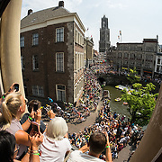Nederland, Utrecht, 05-07-2015  The Tour de France riders continue after the official start ceremony along the Oudegracht for the second stage heading for Zeeland. The iconic Dom tower seen in the back.  Foto: Til & Wijnbergh  Hollandse Hoogte