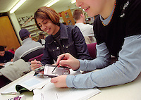 Sixth form students using handheld  personal computers to help with school work.