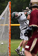 (060509 Plymouth, MA)   Duxbury's goalie Makar Zaverucha, 3, looks back at the ball after BC High scored during their game at Plymouth North High School.