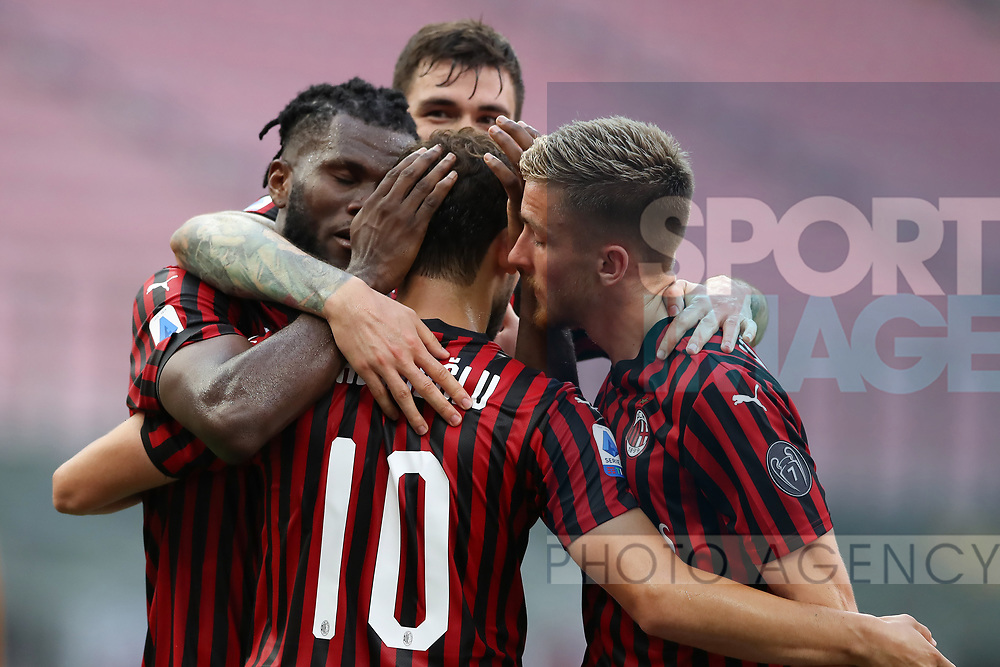 AC Milan players celebrate after Turkish midfielder Hakan Calhanoglu scored form the penalty mark to give the side a 2-0 lead during the Serie A match at Giuseppe Meazza, Milan. Picture date: 28th June 2020. Picture credit should read: Jonathan Moscrop/Sportimage