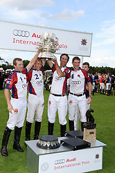 The Audi England team, JAMES BEIM, MARK TOMLINSON, JOHN PAUL CLARKIN and  LUKE TOMLINSON and the Westchester Cup at the Audi International Polo at Guards Polo Windsor Great Park, Egham, Surrey on 28th July 2013.