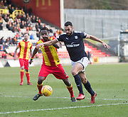 17th February 2018, Firhill Stadium, Glasgow, Scotland; Scottish Premier League Football, Partick Thistle versus Dundee; Steven Caulker of Dundee runs at Abdul Osman of Partick Thistle