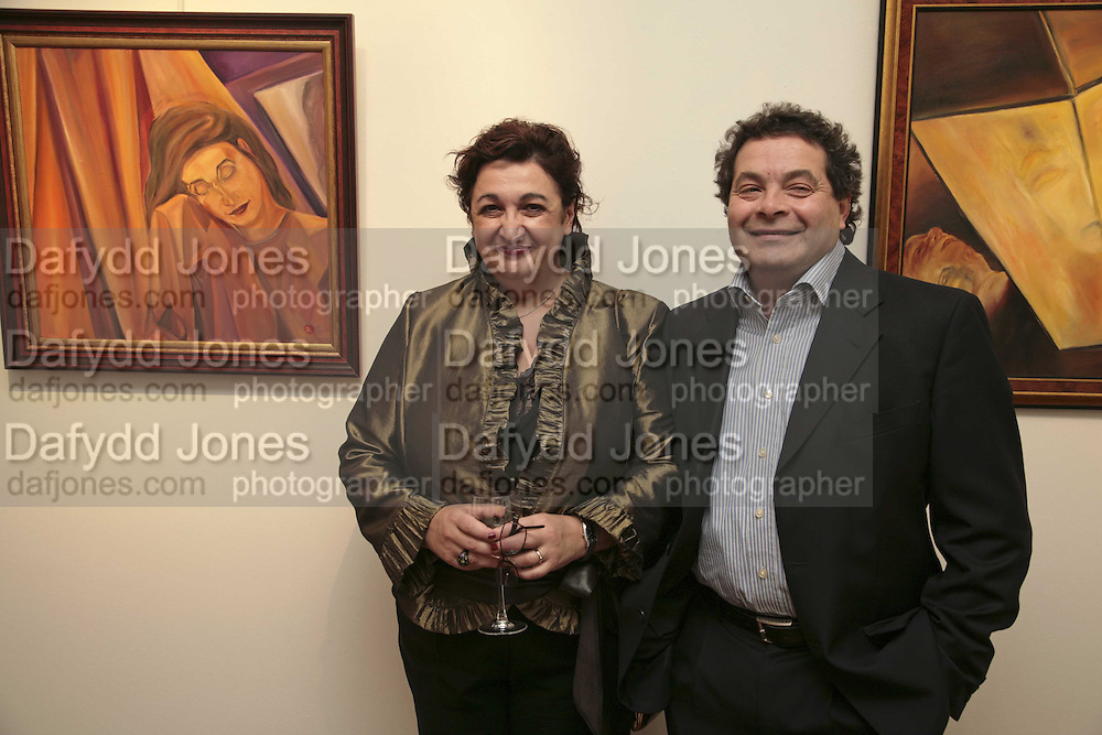 Inna and Michael  Rogatchi, The Real Dream, private view for an exhibition of work by Michael Rogatchi. Cork St. London.  5 December 2006. ONE TIME USE ONLY - DO NOT ARCHIVE  © Copyright Photograph by Dafydd Jones 248 CLAPHAM PARK RD. LONDON SW90PZ.  Tel 020 7733 0108 www.dafjones.com