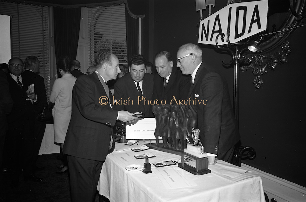 05/04/1966<br /> 04/05/1966<br /> 05 April 1966<br /> Presentation Awards for entries in the N.A.I.D.A. Parade at the Shelbourne Hotel, Dublin. Photo shows  (l-r): Mr. L.V. Nolan, President of the N.A.I.D.A., admiring the awards with the three major award winners, Mr. W.J. O'Toole, Sales Promotion, W. & R. Jacob and Co., Ltd. (2nd);   Mr. Aidan Creedon, Managing Director, Gypsum Industries Ltd. (1st) and Mr. Bob McElheron, Information Officer, C.I.E. (3rd).