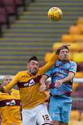 3rd November 2018, Fir Park, Motherwell, Scotland; Ladbrokes Premiership football, Motherwell versus Dundee; Darren O'Dea of Dundee competes in the air with Ryan Bowman of Motherwell