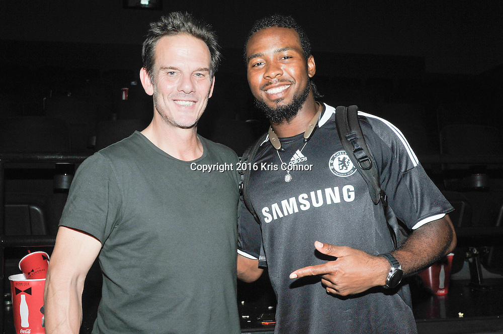 RICHMOND, VA - AUG 13: Director Peter Berg, and Washington Redskin player Josh Norman attends a special screening for the Washington Redskins football team of Lions gate Entertainment's new movie Deepwater Horizon at Bow Tie Cinema on August 13, 2016 in Richmond, Va. (Photo by Kris Connor for Lions Gate Entertainment)