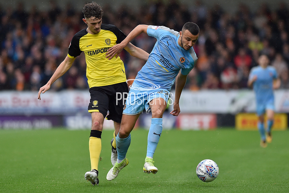 Burton Albion defender Tom Flanagan battles for the ball with Wolverhampton Wanderers midfielder Romain Saiss (27) during the EFL Sky Bet Championship match between Burton Albion and Wolverhampton Wanderers at the Pirelli Stadium, Burton upon Trent, England on 30 September 2017. Photo by Richard Holmes.