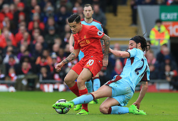 Burnley's George Boyd (right) dispossesses Liverpool's Philippe Coutinho during the Premier League match at Anfield, Liverpool.