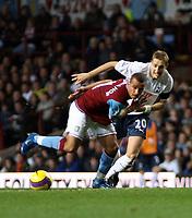 Photo: Mark Stephenson/Sportsbeat Images.<br /> Aston Villa v Tottenham Hotspur. The FA Barclays Premiership. 01/01/2008.Villa's Gabriel Agbonlahor holds off Tottenham's Michael Dawson
