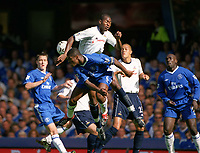 Marcel Desailly (Chelsea) jumps for the ball with Anthony Gardener (Tottenham) Chelsea v Tottenham Hotspur, FA Premiership, 13/09/2003. Credit: Colorsport / Matthew Impey
